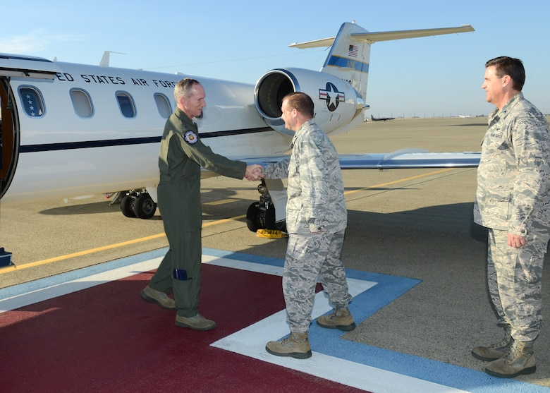 Gen. Mike Hostage, commander of Air Combat Command, greets Col. Phil Stewart, 9th Reconnaissance Wing commander, during a visit to Beale Air Force Base, Calif., Jan. 14, 2014. Hostage toured Beale and held a Q&A during an Airmen's call. (U.S. Air Force photo by John Schwab)