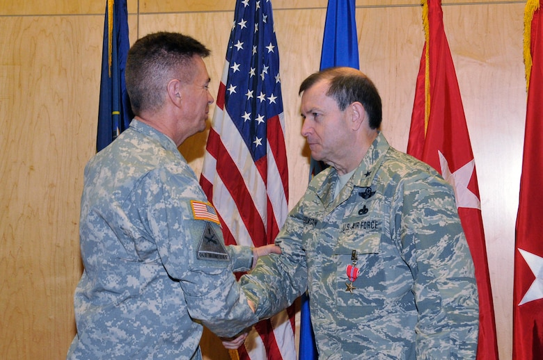 Maj. Gen. Jefferson S. Burton, Adjutant General of the Utah National guard, presents a Bronze Star Medal to Brig. Gen. David R. Fountain, the Assistant Adjutant General for Air, Joint Task Force Headquarters, Utah Air National Guard, on January 11, 2014.  Fountain received the award for meritorious achievement during his deployment in support of Operation Enduring Freedom from March 28, 2013 to January 8, 2014. (Utah National Guard Photo by SSgt Annie Edwards/Released)