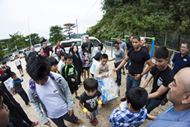 Station residents from Marine Corps Air Station Iwakuni greet children from a children's home in Yamaguchi city during a Single Marine Program trip, Oct. 19, 2013. Volunteers brought toys collected via the SMP.