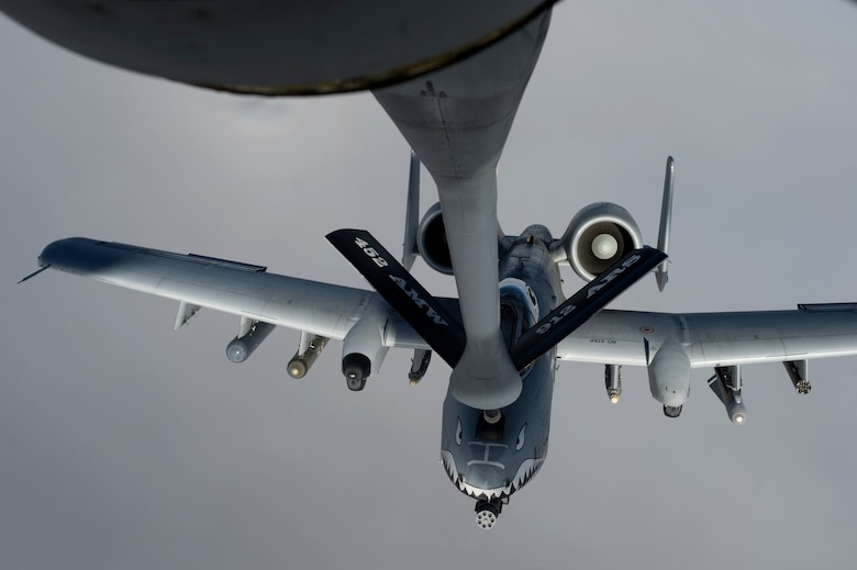 A KC-135 Stratotanker refuels an A-10 Thunderbolt II from the 74th Expeditionary Fighter Squadron, Bagram Airfield, Afghanistan Jan. 7, 2014, over northeast Afghanistan. The crew of the Stratotanker provided fuel for coalition aircraft during a more than 10-hour combat sortie. The KC-135 is from the 340th Expeditionary Air Refueling Squadron in Southwest Asia. (U.S. Air Force photo/Tech. Sgt. Jason Robertson)