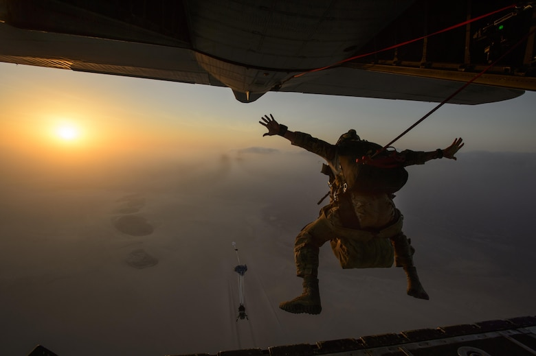 A pararescueman assigned to the 82nd Expeditionary Rescue Squadron jumps from a HC-130J Combat King Jan. 9, 2014, near Camp Lemonnier, Djibouti. Airmen with the 82nd ERS are first responders for personnel recovery at the Combined Joint Task Force Horn Of Africa. Their mission in Djibouti is to provide personnel recovery coverage for both fixed and rotary wing aircraft. (U.S. Air Force photo/Staff Sgt. Staci Miller)