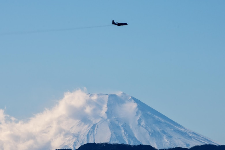 A C-130 Hercules with the 36th Airlift Squadron flies over Yokota Air Base, Japan, during a routine sortie Jan. 10, 2014. After completing missions in Bangladesh, Philippines and Guam, the 36th AS regularly conducts training missions to remain proficient in the necessary skills to support any contingency. (U.S. Air Force photo/Osakabe Yasuo)