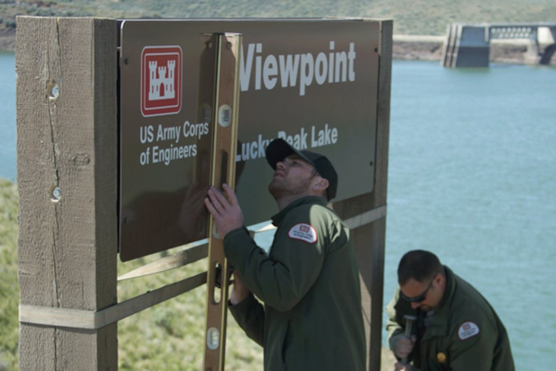 Park Rangers install a new identification sign at Lucky Peak Lake's Viewpoint.