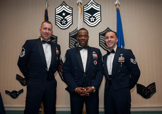 From left to right: Master Sgt. Bryon Barron, 673rd Air Base Wing Airman Leadership School instructor, Master Sgt. Jerrme Stanton, 51st Force Support Squadron ALS commandant, and Staff Sgt. Edward White, 18th Wing ALS instructor, pose for a photo after graduating a class at Kunsan Air Base, Republic of Korea, Dec. 17, 2013. Stanton is the commandant of ALS for the entire Korean peninsula and works with Pacific Air Forces to bring ALS instructors to the ROK. These instructors ensure that Airmen continue their professional development while stationed in the Republic of Korea. (U.S. Air Force photo by Senior Airman Clayton Lenhardt/Released)