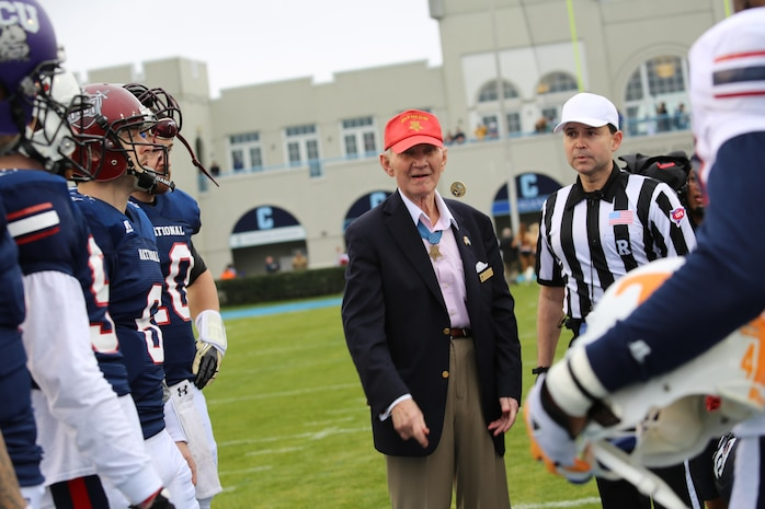 Retired Marine Maj. Gen. James Livingston, a Congressional Medal of Honor recipient, flips the coin before the kickoff during the Medal Of Honor Bowl at the Johnson Hagood Memorial Stadium in Charleston, S.C., Jan. 11. Livingston received the Medal of Honor for his role as an infantry company commander at Dai Do, Vietnam, during a three-day battle in which the 2nd Battalion, 4th Marine Regiment, numbering only 800 men, defeated 10,000 or more North Vietnamese Army soldiers.