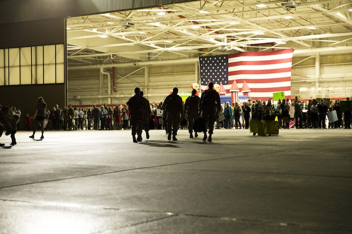 Marines with Marine Aviation Logistics Squadron 31 see their families for the first time after a deployment, Jan. 10. The Marines were attached to MALS-40 for the six-month deployment to Afghanistan.