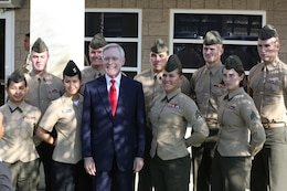 Secretary of the Navy Ray Mabus, poses with a group of Marines aboard Camp Pendleton, Calif., Jan. 10. Mabus had lunch with a group of non-commissioned officers to discuss questions and concerns they had regarding the Marine Corps.