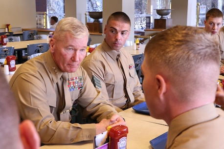 I Marine Expeditionary Force Commanding General, Lt. Gen. John A. Toolan, sits with a group of Marines aboard Camp Pendleton, Calif., Jan. 10. Marines had an opportunity to ask and discuss questions they had about I MEF and the Marine Corps.