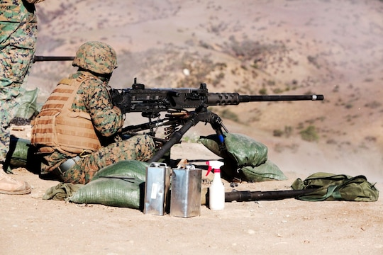 Lance Cpl. Alex Cruz, a Marine with 1st Combat Engineer Battalion, fires a Browning .50 caliber machine gun aboard Camp Pendleton, Calif., Jan. 15. The Marines from 1st CEB participated in a two-week machine gunners course.