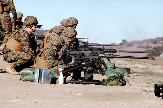 Marines with 1st Combat Engineer Battalion line up on the firing line at a range aboard Camp Pendleton, Calif., Jan. 15. The Marines fired the Browning .50 caliber machine gun as part of a non-infantry machine gunners course.