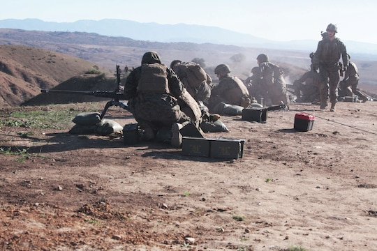 Marines feed ammunition into the browning .50 caliber machine gun during a machine gunners course aboard Camp Pendleton, Calif., Jan. 15. The course was approximately two weeks long and taught the Marines how to operate machine guns effectively.
