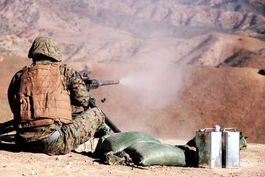 Lance Cpl. Alex Cruz, a Marine with 1st Combat Engineer Battalion, fires a Browning .50 caliber machine gun aboard Camp Pendleton, Calif., Jan. 15. The Marines fired four different machine guns during the two-week machine gunners course.