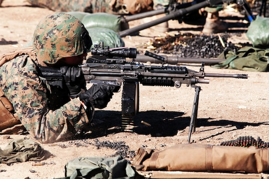 Lance Cpl. Daniel Vitellaro, a Marine with 1st Combat Engineer Battalion, fires a M249 light machine gun during a two-week machine gunners course aboard Camp Pendleton, Calif., Jan. 15. The course taught the Marines how to effectively operate machine guns in combat scenarios.