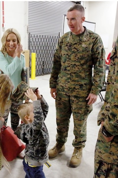 Lt. Col. Brian Russell, the commanding officer of 1st Air Naval Gunfire Liaison Company, welcomes the Daggett family to ANGLICOs town hall meeting aboard Camp Pendleton, Calif., Jan 15. The meeting allowed families to ask questions and get a better sense of ANGLICO's structure and purpose.