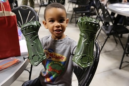 A child shows off his new toy he received at 1st Air Naval Liaison Gunfire Company's town hall meeting aboard Camp Pendleton, Calif., Jan. 15. The meeting allowed families to ask questions and get a better sense of ANGLICO's structure and purpose.