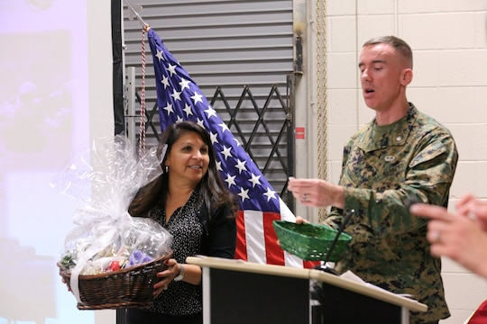 Lt. Col. Brian Russell, the commanding officer of 1st Air Naval Gunfire Liaison Company, and Missy Harrison, 1st ANGLICO's family readiness officer, announce the winner of the raffle at a town hall meeting aboard Camp Pendleton, Calif., Jan 15. The meeting allowed families to ask questions and get a better sense of ANGLICO's structure and purpose.