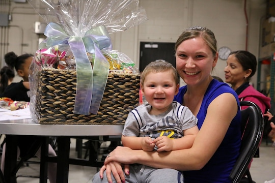 Olga Hasting and her son pose with their raffle prize at 1st Air Naval Gunfire Liaison Company's town hall meeting aboard Camp Pendleton, Calif., Jan. 15. The meeting allowed families to ask questions and get a better sense of ANGLICO's structure and purpose.