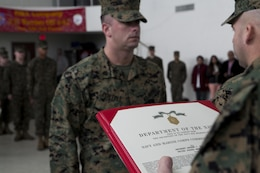 Sgt. Andrew Portell, funeral honors noncommissioned officer-in-charge, 3rd Battalion, 23rd Marine Regiment, is awarded the Navy and Marine Corps Commendation Medal at their home training center in Bridgeton, Mo., Jan 7. Portell received the award for his role in coordinating more than 1,000 funeral honors ceremonies, 623 of which he personally conducted. (U.S. Marine Corps
