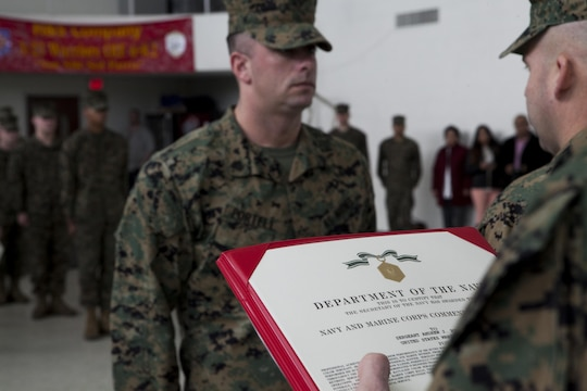 Sgt. Andrew Portell, funeral honors noncommissioned officer-in-charge, 3rd Battalion, 23rd Marine Regiment, is awarded the Navy and Marine Corps Commendation Medal at their home training center in Bridgeton, Mo., Jan 7. Portell received the award for his role in coordinating more than 1,000 funeral honors ceremonies, 623 of which he personally conducted. (U.S. Marine Corps photo by Sgt. Michael Ito)