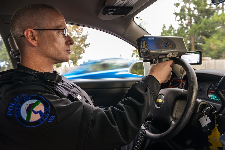 Master Sgt. Phil Ryan, 62nd Airlift Wing Inspector General complaint resolution superintendent, also a reserve police officer at the Yelm Police Department, monitors drivers' speed with a radar detector, Dec. 14, 2013, in Yelm, Wash. Ryan has more approximately 800 hours experience as a volunteer police officer. (U.S. Air Force photo/Tech. Sgt. Sean Tobin)