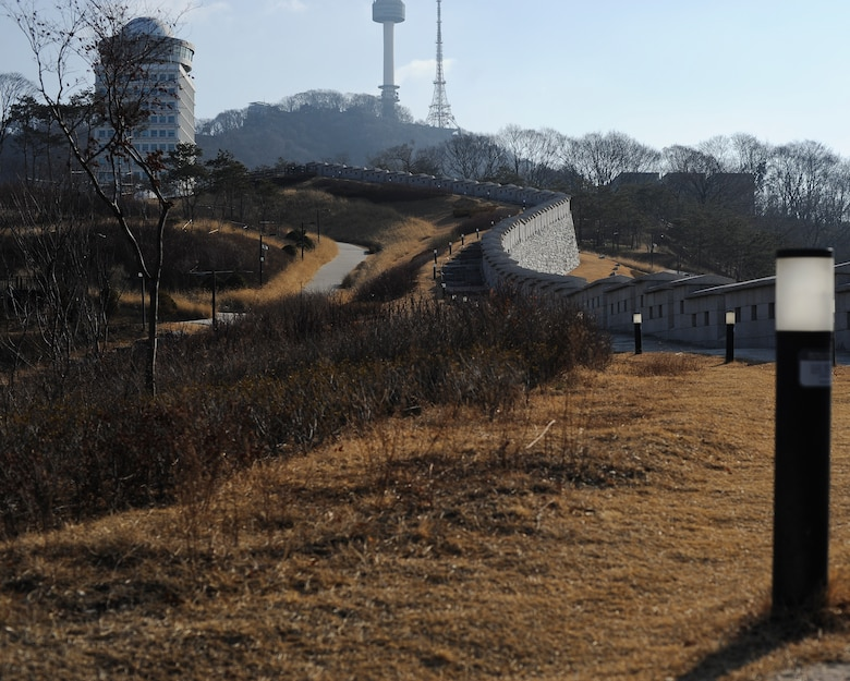 The Fortress Wall in Namsan Park leads to the top of Namsan Mountain and N Seoul Tower, as pictured here Jan. 18, 2014, in Seoul, Republic of Korea. Originally built around 1395, the Fortress Wall of Seoul served as a defense barreir for the Joseon dynasty. (U.S. Air Force photo by Staff Sgt. Jake Barreiro)