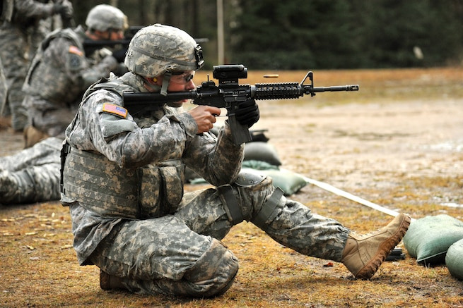 u s department of > photos > photo essays > essay view u s army spc joshua sellers fires his m4 carbine rifle during a weapons qualification at
