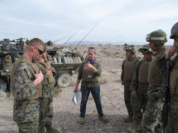 Rebecca Jaworski, a Marine Corps Systems Command biomedical engineer, explains fit and function of the fighting jacket variant of the modular scalable vest to the Marines of 1st Light Armored Reconnaissance battalion. Jaworski and fellow MCSC employee Mackie Jordan, an engineer (not pictured), spent several days embedded with the Marines of the 1st LAR during field exercises this November.