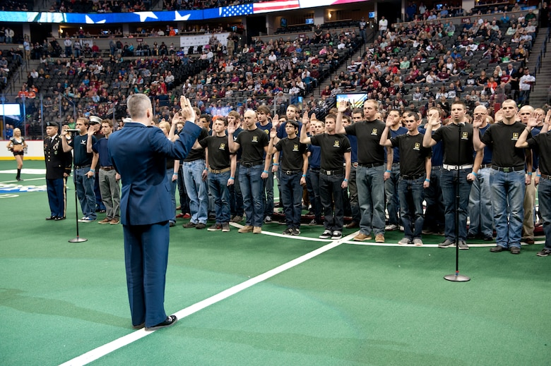Lt. Col. Darrel Smith, 467th Recruiting Squadron commander, delivers the Oath of Enlistment to more than 60 military recruits during the Colorado Mammoth Lacrosse Military Appreciation Night halftime Jan. 18, 2014, at the Pepsi Center in Denver. The Air Force, Army, Marine, Navy and Coast Guard recruits recited the Oath of Enlistment, dedicating themselves to the service of their country in front of 17,000 lacrosse fans. (U.S. Air Force photo by Senior Airman Phillip Houk/Released)