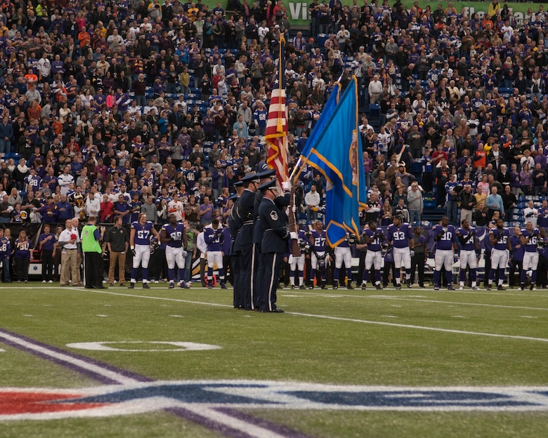 The 133rd Airlift Wing's base honor guard posts the colors at the Minnesota Vikings verses the Chicago Bears game at Mall America Field in Minneapolis, Minn., Dec. 1, 2013.