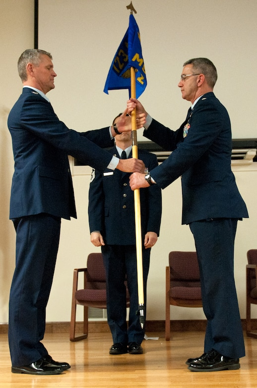 Lt. Col. Matt Stone (right) receives the guidon of the 123rd Mission Support Group from Col. Barry Gorter, commander of the 123rd Airlift Wing, during a change-of-command ceremony held at the Kentucky Air National Guard Base in Louisville, Ky., Jan. 11, 2014. As the group's newest commander, Stone replaces Col. Jeffrey Peters, who is retiring from military service. (U.S. Air National Guard photo by Airman 1st Class Joshua Horton)