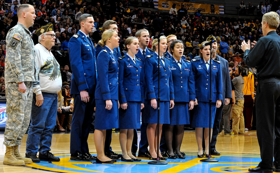 The Air Force Academy Cadet Chorale paired with veterans and a Soldier to perform at the Denver Nuggets vs. Cleveland Cavaliers game Jan. 17, 2014, at the Pepsi Center in Denver. The Nuggets showed their appreciation for service members by honoring all branches of military service at the game. (U.S. Air Force photo by Airman 1st Class Samantha Saulsbury/Released)