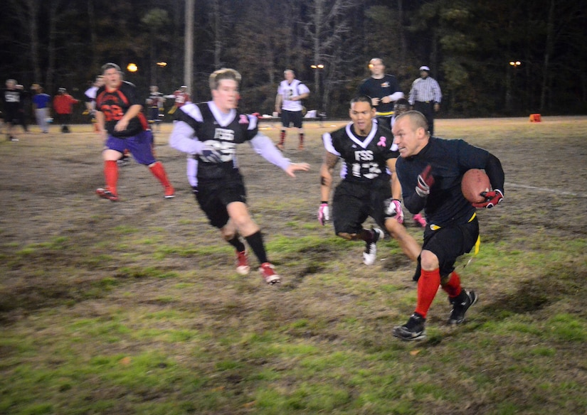 Ryan Mathesius, 628th Civil Engineer Squadron running back, gains yards after a catch during the Intramural Flag Football Championship game at Joint Base Charleston – Air Base, S.C., Jan. 17, 2014. CES beat the 628th Force Support Squadron 13-12 to win back-to-back championships. (U.S. Air Force photo/Staff Sgt. William O'Brien)