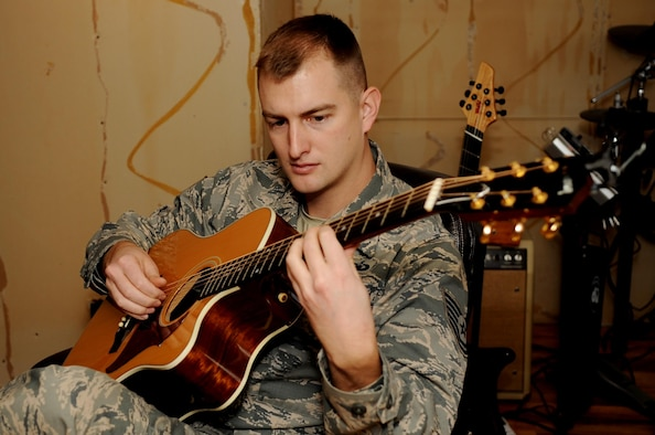 Air Force Reserve Tech. Sgt. Stephen Froeber plays guitar inside his home studio at Hampton, Va., Jan. 10, 2014. He is an aerospace control and warning systems manager with the 710th Comat Operations Squadron at Joint Base Langley-Eustis, Va. Froeber said the skills he learned as an Airman helped him develop a career as a freelance composer. (U.S. Air Force photo by Staff Sgt. Jarad A. Denton)