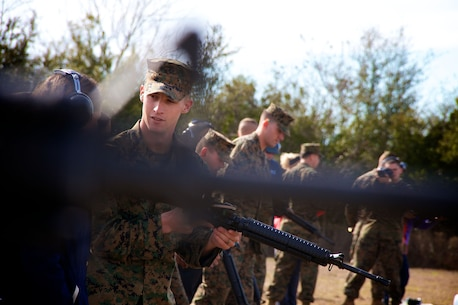Marines with Weapons and Field Training Battalion, Recruit Training Regiment, Marine Corps Recruit Depot Parris Island, S.C., instruct a group of teachers from south Florida and Puerto Rico on the proper handling and use of the M16A4 Carbine Jan. 15, 2014. Each year, hundreds of high school educators participate in the Marine Corps' Educator's Workshop to get a deeper understanding of how the Corps makes Marines.