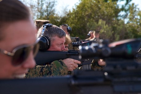Sean Gallagan, the Principal of George T. Baker High School in Miami, fires an M16A4 Carbine during a visit to Marine Corps Recruit Depot Parris Island, S.C., Jan. 15, 2014. Each year, hundreds of high school educators participate in the Marine Corps' Educator's Workshop to get a deeper understanding of how the Corps makes Marines.