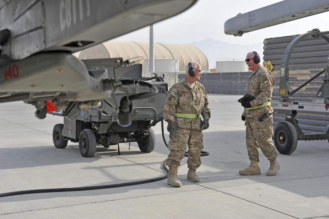 Master Sgt. Doyle Easterling and Senior Master Sgt. Paul Jordan share a light moment together at the end of a sucessful F-16 engine test run at Bagram Airfield, Afghanistan, Jan. 20, 2014. Both are deployed out of Carswell Joint Reserve Base in Fort Worth, Texas to Bagram, and will be retiring this year after a combined 78 years of military service. (U.S. Air Force photo by Senior Master Sgt. Gary J. Rihn)