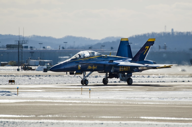 A U.S. Navy Blue Angels F/A-18 Hornet fighter jet and two aircrew members arrive at Louisville International Airport in Louisville, Ky., on Jan. 23, 2014, for a planning session at the Kentucky Air National Guard Base in preparation for the Thunder Over Louisville air show, scheduled for April 12. The Kentucky Air Guard is providing hundreds of hours of support to military aircraft flying in the show. (U.S. Air National Guard photo by Master Sgt. Phil Speck)
