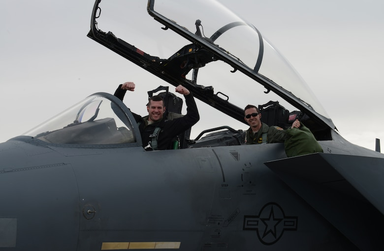 Capt. Benjamin Hoffman, 391st Fighter Squadron training officer, and 1st Lt. Matthew Martinez, 391st FS weapons system officer, cheer after landing their F-15E Strike Eagle Jan. 23, 2013, at Nellis Air Force Base, Nev. Members of the 366th Fighter Wing from Mountain Home Air Force Base, Idaho, waited more than three hours due to foggy conditions before being allowed to set out for Nellis AFB to participate in the combat exercise Red Flag 14-1. (U.S. Air Force photo by Senior Airman Benjamin Sutton/Released)