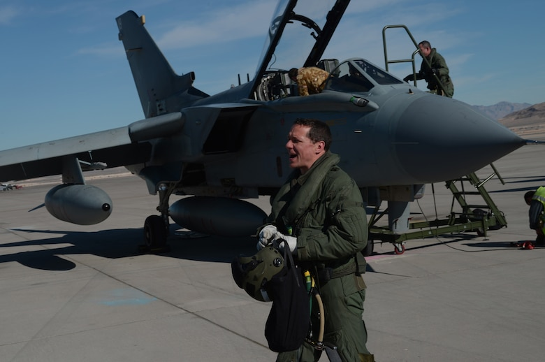 Wing Commander Chris Snaith, British Royal Air Force  IX (B) Squadron, yells hello to a ground crew member Jan. 22, 2013, at Nellis Air Force Base, Nev. Snaith who was educated at the Douglas Academy,Glasgow, Scotland, joined the Royal Air Force as a University Cadet in 1991. Snaith and his squadron are here to participate in the combat exercise Red Flag 14-1. (U.S. Air Force photo by Senior Airman Benjamin Sutton/Released)