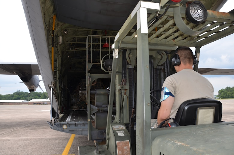 An Airman assigned to the 103rd Logistics Readiness Squadron downloads cargo from a C-130 June 26, 2013, at Bradley Air National Guard Base, East Granby, Conn.  (U.S. Air National Guard photo by Maj. Jefferson S. Heiland)