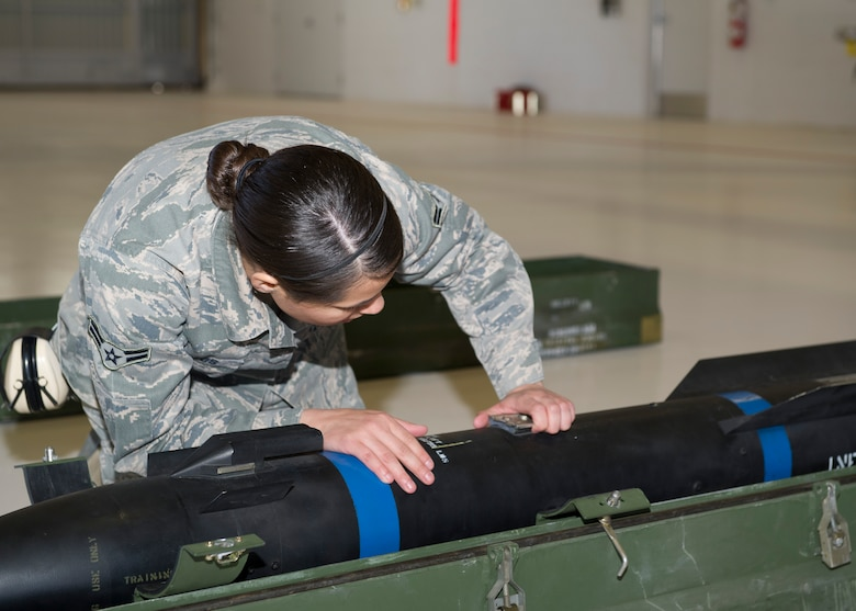 Airman 1st Class Chelsea Cavazos, 849th Aircraft Maintenance Squadron weapons-load-crew member, inspects an inert missile for damage during a quarterly load crew competition at Holloman Air Force Base, N.M., Jan. 17. The 849th AMXS pitted two MQ-1 Predator load crews against each other to evaluate who could prepare the aircraft for combat the quickest and with the fewest procedural errors. (U.S. Air Force photo by Airman 1st Class Chase Cannon/Released)