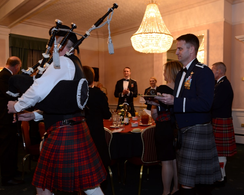 U.S. Air Force Col. David Cox, right, 100th Air Refueling Wing vice commander, carries a platter of haggis during the British-American Committee Burns Night supper Jan. 18, 2014, in Middleton Hall on RAF Mildenhall, England. The committee hosts this and other social events each year, bringing both communities together for a richer cultural experience. (U.S. Air Force photo by Airman 1st Class Preston Webb/Released)