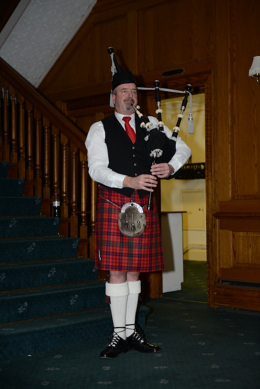 A traditional Scottish bagpiper plays at the British-American Committee Burns Night supper Jan. 18, 2014, in Middleton Hall on RAF Mildenhall, England. Those attending wear traditional Scottish dress to pay homage to Robert Burns. (U.S. Air Force photo by Airman 1st Class Preston Webb/Released)