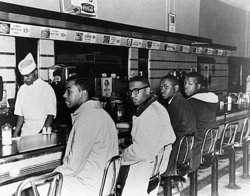 As a young college student in 1960, McNeil (far left) and three of his friends staged a protest at a lunch counter inside a Woolworth store in Greensboro, N.C. They refused to move when they were told the facility did not serve blacks. Their protest quickly spread to lunch counters in 54 cities in nine states.