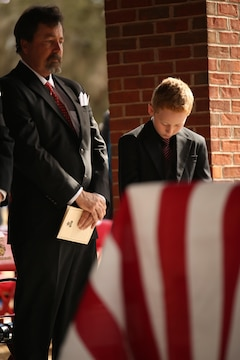 Medal of Honor recipient John James McGinty III's son and grandson attend his funeral Jan. 23, 2014, at Beaufort National Cemetery in Beaufort, S.C. McGinty, a decorated Vietnam War hero and Parris Island veteran, died Jan. 17, 2014, in his home in Beaufort at the age of 73.