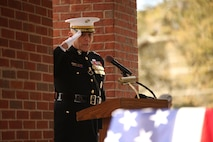 Gen. John Paxton Jr., assistant Commandant of the Marine Corps, salutes the casket of Medal of Honor recipient John James McGinty III, on Jan. 23, 2014, after speaking at McGinty's funeral held at Beaufort National Cemetery in Beaufort, S.C. McGinty, a decorated Vietnam War hero and Parris Island veteran, died Jan. 17, 2014, in his home in Beaufort at the age of 73.