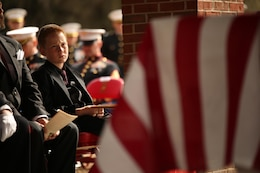 Medal of Honor recipient John James McGinty III's grandson watches his grandfather's funeral proceedings Jan. 23, 2014, at Beaufort National Cemetery in Beaufort, S.C. McGinty, a decorated Vietnam War hero and Parris Island veteran, died Jan. 17, 2014, in his home in Beaufort at the age of 73.