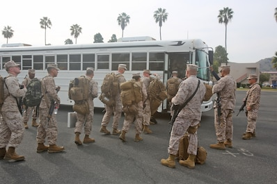 Marines with Combat Logistics Battalion 7, Combat Logistics Regiment 1, 1st Marine Logistics Group, board buses as they start their trip to Afghanistan aboard Camp  Pendleton, Calif., Jan. 10, 2014. They bid their loved ones farewell as they departed for a six-month-long deployment to Camp Leatherneck alongside corpsmen with  1st Medical Battalion, 1st MLG. Marines with CLB-7, along with elements of 1st Explosive Ordnance Disposal Company, 1st Medical Battalion, 1st Dental Battalion and 7th Engineer Support Battalion, will support I Marine Expeditionary Force (Fwd) in assuming responsibilities as the logistics battalion for Regional Command (Southwest).