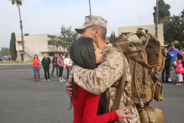 First Lt. Ricky Mansyur, a supply officer with Combat Logistics Battalion 7, Combat Logistics Regiment 1, 1st Marine Logistics Group, hugs his wife, Megan, before boarding a bus as part of his first step of traveling to Camp Leatherneck, Afghanistan, from Camp Pendleton, Calif., Jan. 10, 2014 Marines with CLB-7, along with elements of 1st Explosive Ordnance Disposal Company, 1st Medical Battalion, 1st Dental Battalion and 7th Engineer Support Battalion, will support I Marine Expeditionary Force (Fwd) in assuming responsibilities as the logistics battalion for Regional Command (Southwest). Mansyur is a native of New Jersey, N.J.