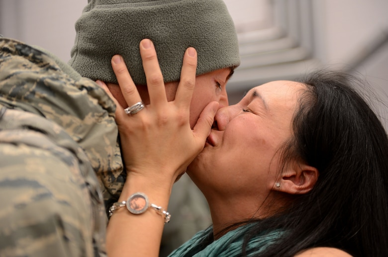 Capt. Joe Faraone reunites with his wife, Suk, Jan. 15, 2014, at Spangdahlem Air Base, Germany, The Airman returned from a deployment to Southwest Asia in support of Operation Enduring Freedom. Faraone serves with the 606th Air Control Squadron. (U.S. Air Force photo/Airman 1st Class Kyle Gese)